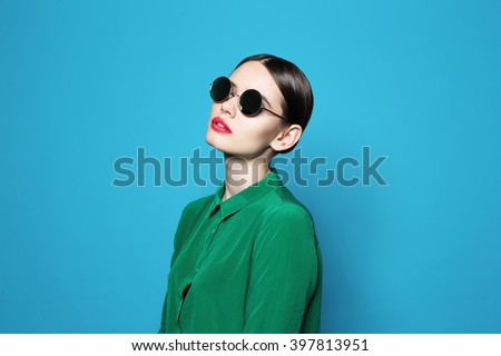fashion model in sunglasses , beautiful young woman. Studio shot #397813951
