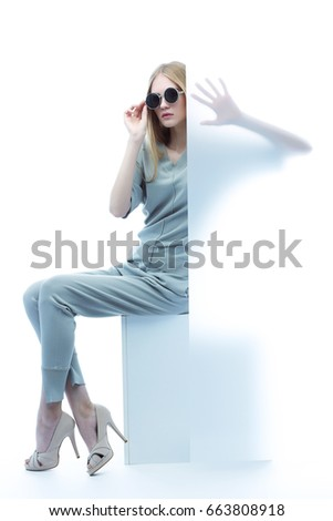 Fashion model in sunglasses, beautiful young woman. Studio shot