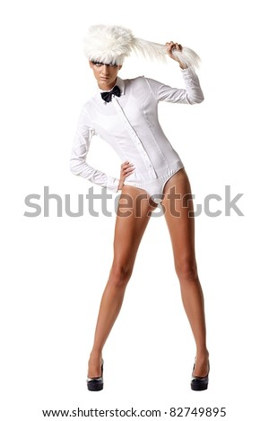 Fashion model in white combi dress and white fur hat. Isolated over white
