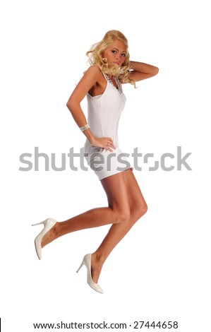 Fashion model jumping isolated against a white background