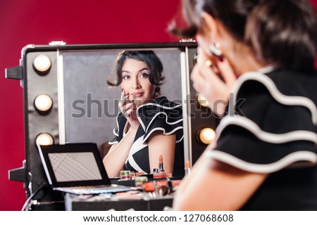 fashion model makeup at the mirror