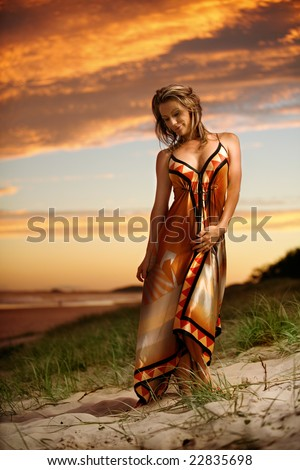 Fashion model on beach at sunset