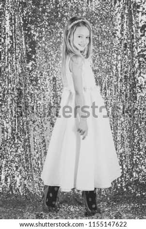Fashion model on silver background, beauty. Little girl in fashionable dress, prom. Fashion and beauty, little princess. Look, hairdresser, makeup. Child girl in stylish glamour dress, elegance #1155147622