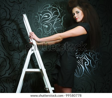 Stock Photo fashion model on the ladder