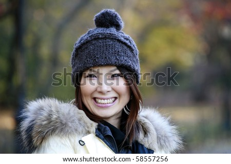 Fashion model poses in Central Park New York.  She was 23 at the time of shoot and of japanese ethnicity.  Photographed November, 2007. - stock photo