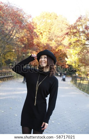 Fashion model poses in Central Park New York.  She was 23 at the time of shoot and of Japanese ethnicity.  Photographed November, 2007.