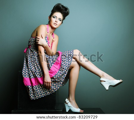 Fashion model. Posing in studio