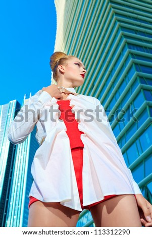 Fashion model posing over big city background.