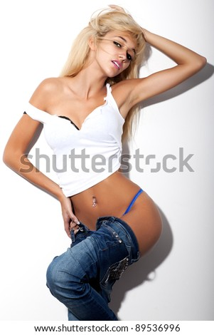 fashion model posing with jeans