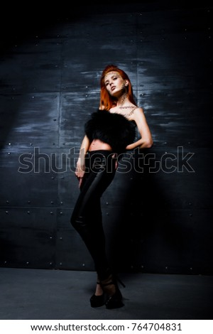 Fashion model red haired girl with originally make up like leopard predator against steel wall. Studio portrait. #764704831