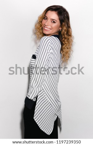 Fashion model, smiling model, curly model in a studio