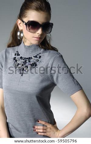 fashion model wearing modern sunglasses.