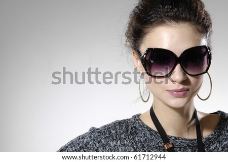 Fashion model wearing modern sunglasses.-isolated