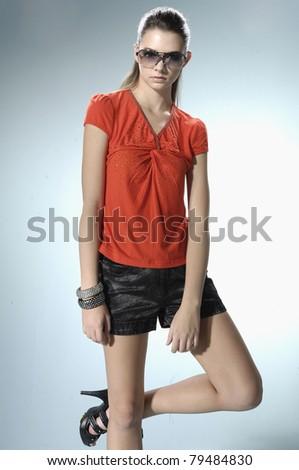 fashion model wearing modern sunglasses posing