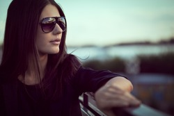 fashion model wearing sunglasses outdoors closeup portrait