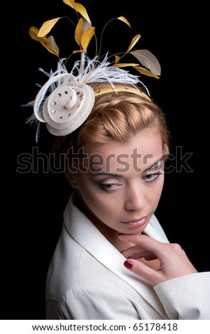 Fashion model with bridal hairstyle, isolated on black