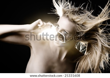 Fashion model with hair blowing around