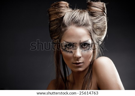 stock photo : Fashion model with halloween makeup and hairstyle on black