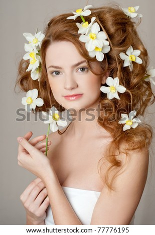fashion model with large hairstyle and flowers in her hair.