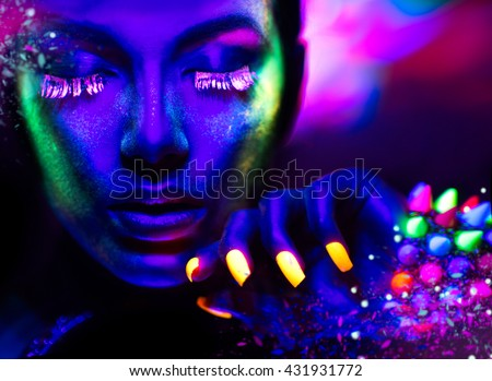 Fashion model woman in neon light, portrait of beautiful model girl with fluorescent make-up, Art design of female disco dancer posing in UV, colorful make up. Isolated on black background #431931772