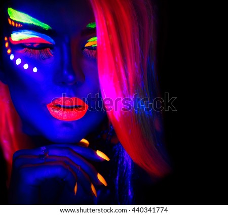Fashion model woman in neon light, portrait of beautiful model girl with fluorescent make-up, Body Art design of female disco dancer posing in UV, painted face, colorful make up, over black background #440341774