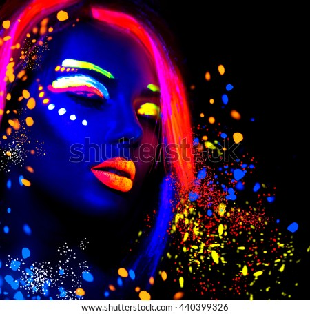 Fashion model woman in neon light, portrait of beautiful model girl with fluorescent make-up, Body Art design of female disco dancer posing in UV, painted face, colorful make up, over black background #440399326