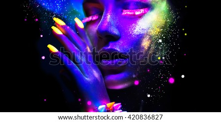 Fashion model woman in neon light, portrait of beautiful model with fluorescent make-up, Art design of female disco dancers posing in UV, colorful make up. Isolated on black background #420836827