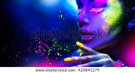 Fashion model woman in neon light, portrait of beautiful model with fluorescent make-up, Art design of female disco dancers posing in UV, colorful make up. Isolated on black background #420841279
