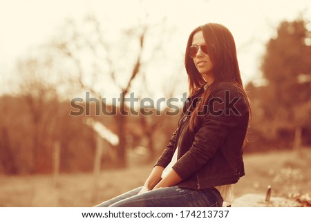 Fashion model woman posing outdoors