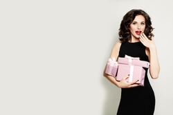 Fashion Model Woman with Gift Box. Happy Surprised Girl. Sale Concept