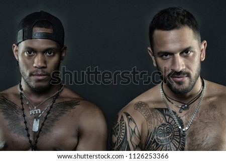 6fa26568165 Fashion models isolated on black background. Brutal men with tattooed  bodies. Sportsmen with muscles