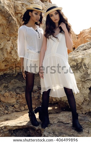 8df4a211a71 fashion outdoor photo of beautiful girls with dark hair wears casual  elegant clothes and hat posing