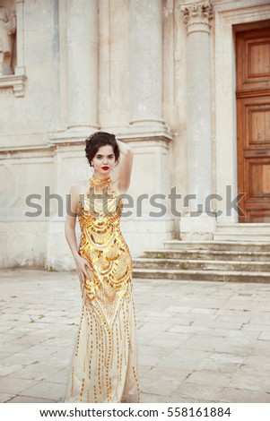 43ee6814df Fashion outdoor photo of fashionable sexy elegant lady wearing in luxury  golden dress. Beautiful young