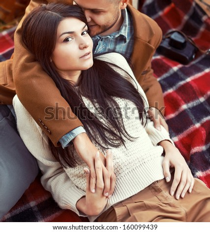 Fashion outdoor sensual portrait of young beautiful couple in love.