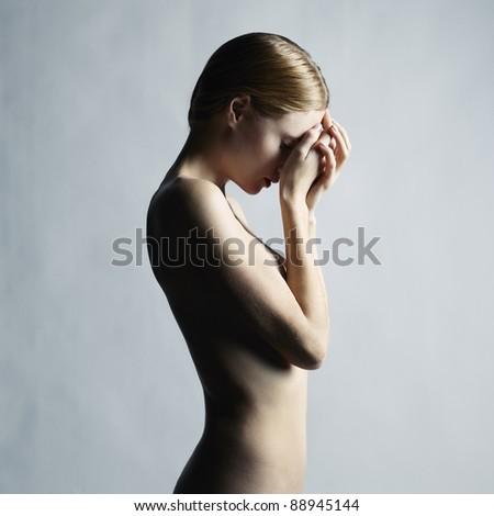 Fashion photo of a beautiful nude woman