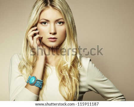 Fashion photo of a young woman with blond hair. Close-up