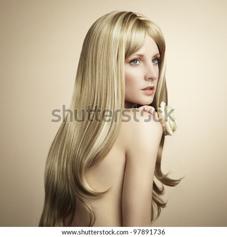 Fashion photo of a young woman with blond hair. Close-up portrait