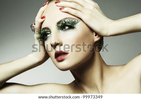 Fashion photo of a young woman with long eyelashes. Close-up portrait - stock photo