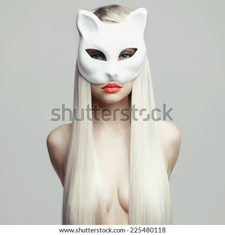 Fashion photo of beautiful sexy blonde in cat mask