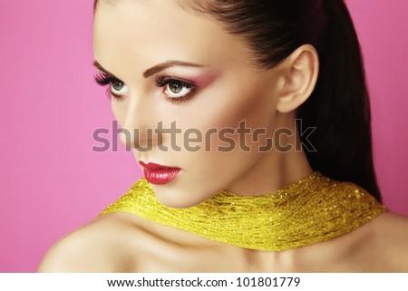 Fashion photo of  beautiful woman on  pink background. Beauty portrait