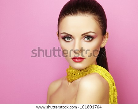 Fashion photo of beautiful woman under a blue veil. Beauty portrait