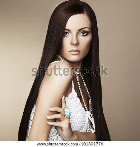 Fashion photo of beautiful woman with magnificent hair. Studio portrait