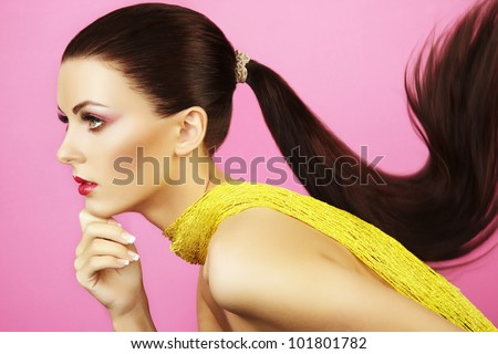 Fashion photo of  beautiful woman with  ponytail. Beauty woman on pink background