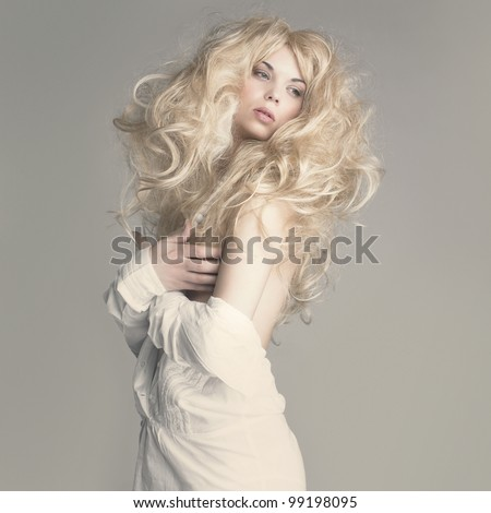 Fashion photo of beautiful woman with sexy body and blond hair
