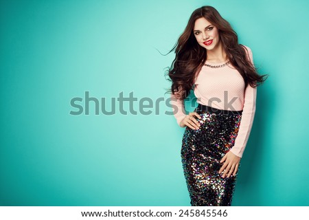 fashion photo of beautiful young woman in nice clothes and small hand purse. Red lips