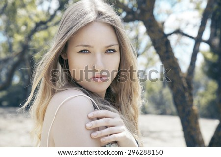Fashion photo of blonde beauty with natural make up and long hair. Autumn portrait. Horizontal, outdoors shot. #296288150