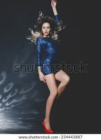 Fashion photo of dancing gorgeous woman in sequined dress #234443887