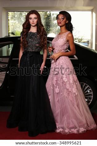 a5ac3f4794d fashion photo of gorgeous women with long dark hair wear luxurious dresses