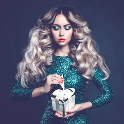Fashion photo of luxury blonde with a gift