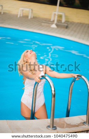 Young woman coming out of the swimming pool Images and Stock